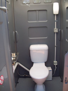 Luxury Sewer Connected Porta loo. Set up by Sydney Bathroom Hire, notice the pump behind the toilet.