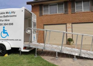 Mobility Access Bathroom set up ready for a client in a wheelchair to use.